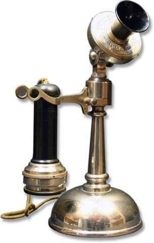 Tapered Shaft Oil-Can Candlestick.