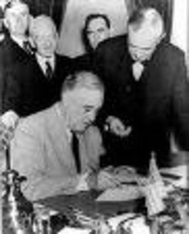 Roosevelt signs Lend-Lease Act