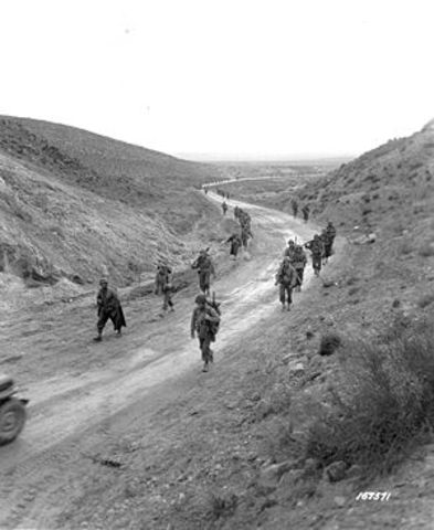 Battle of Kasserine Pass between the U.S. 1st Armored Division and German Panzers in North Africa.