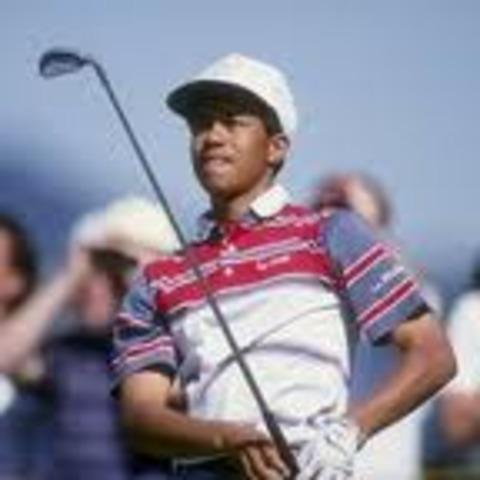 Tiger Woods wins a junior championship.