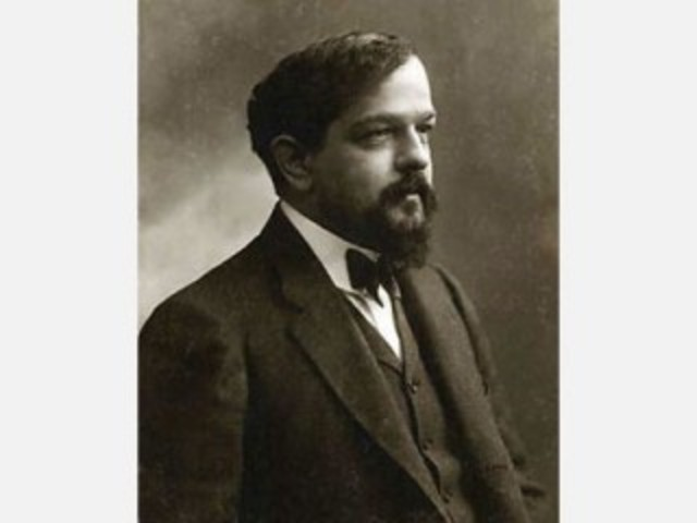 Claude Debussy, French impressionist composer, dies