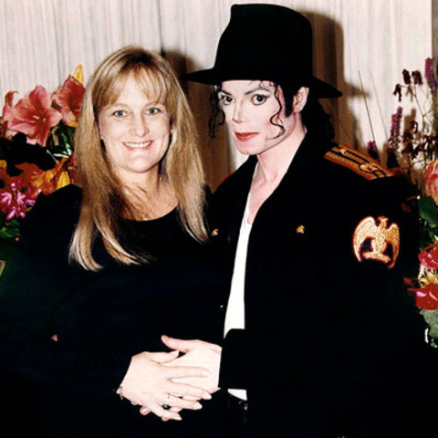 Marries nurse Debbie Rowe