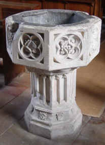 The Baptismal font is late 14th C