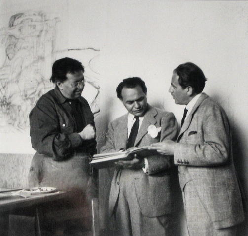 Rivera, Edward G. Robinson, and art dealer Sam Salz visit in Rivera's studio behind the mural in June 1940.