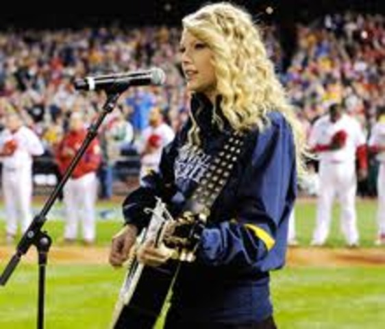 Sang the Star-Spangled Banner at game three of the World Series in Philadelphia.