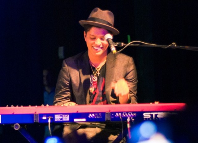 bruno mars plays the piano bass guitar on november 24,2010
