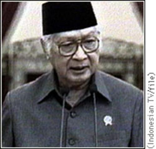 Suharto resigns