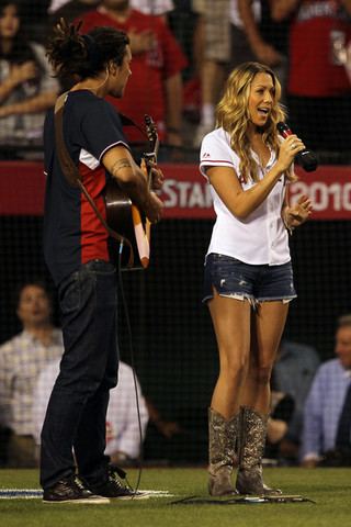 "She performed ""God Bless America"" during the 7th inning stretch at the 2010 Major League All-Star Baseball game. (not the right day)"