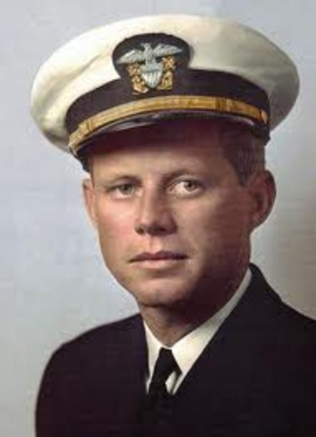 JFK is awarded the Purple Heart and the Navy and Marine Corps Medal for his bravery.