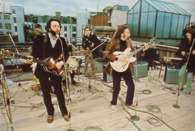 The Beatles give their last public performance