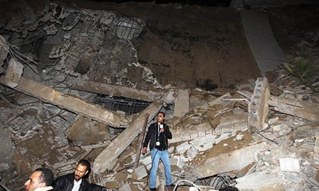 Gaddafi compound hit by coalition air strikes on Tripoli