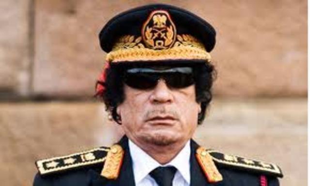 Muammar Gaddafi's 'trophy' body on show in Misrata meat store