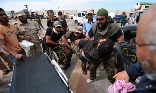 Anti-Gaddafi troops meet fierce resistance in major assault on Sirte