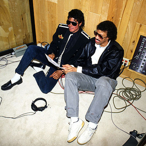 "Jackson and Lionel Richie pen ""We Are The World,"" with the proceeds from sales of the single slated for hunger relief in Africa."