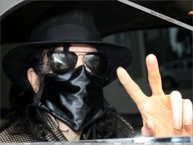 Michael begins to wear a surgical mask in public.
