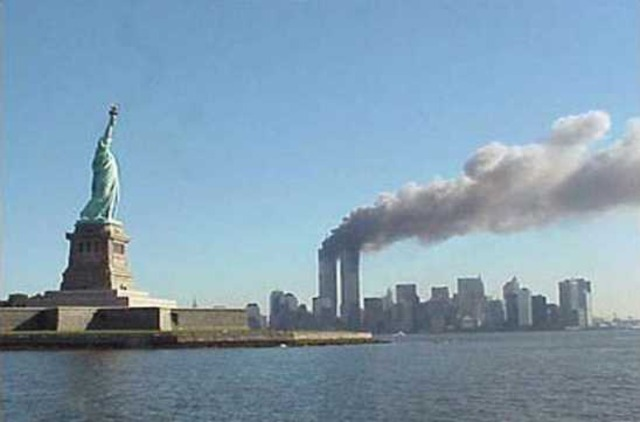 Terrorists crash a plane into the Twin Towers on 9-11