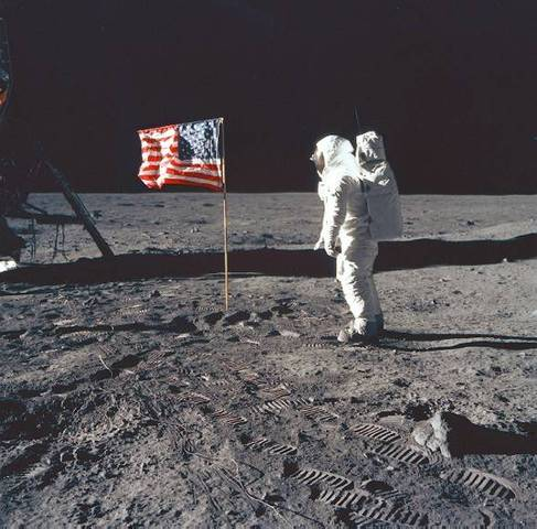 Americans Neil Armstrong and Buzz Aldrin become the first men to walk on the moon