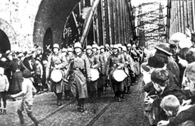 Hitler sends troops into Rhineland