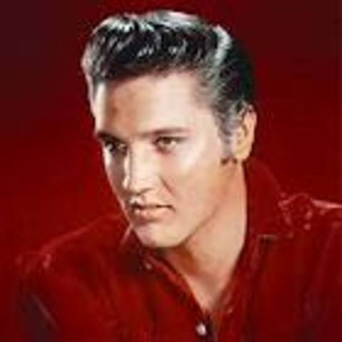 Elvis Presley signs with RCA Records