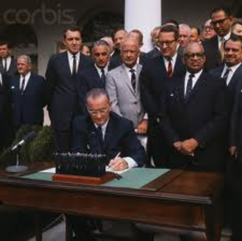 Lyndon B Johnson singed the Civil Rights Act, Making segregation in public places illegal.