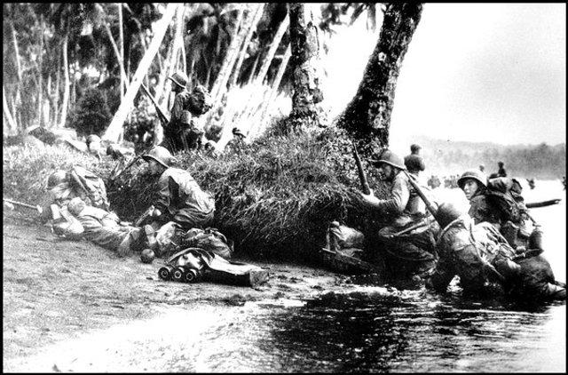 U.S. troops halt the Japanese island-hopping.