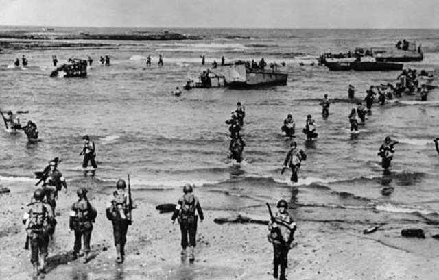 U.S. and British troops land on the beaches of Algeria and Morocco.