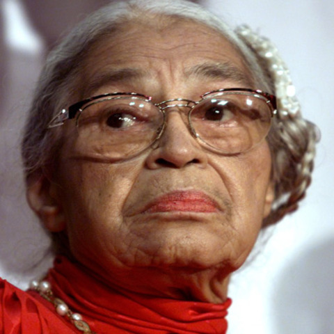 Rosa Parks refuses to sit at the back of a public bus