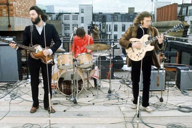 The Beatles make last public performance
