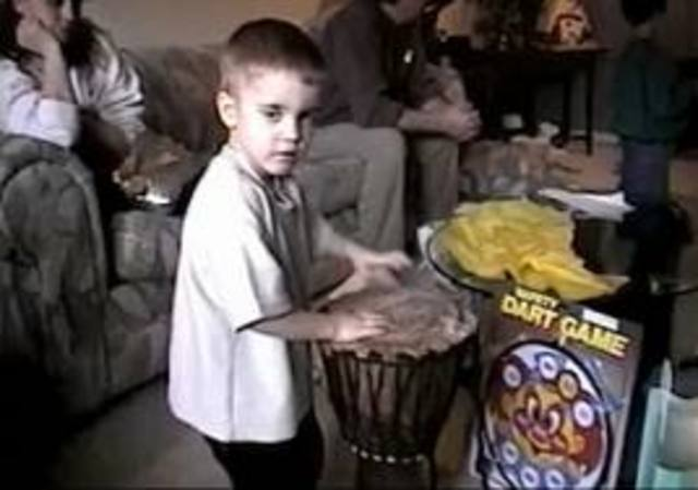 Justin starts playing the drums