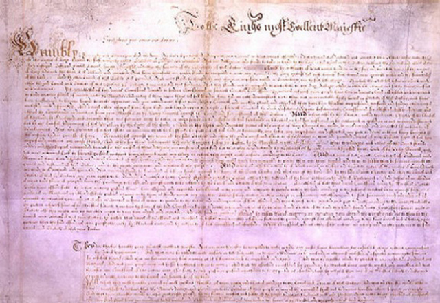 Charles I signs the Petition of Right