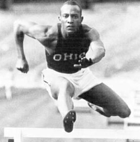 Jessie Owens wins four gold medals at Berlin Olympics