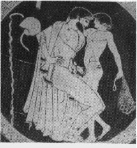 Hombre griego jugando con pene de niño