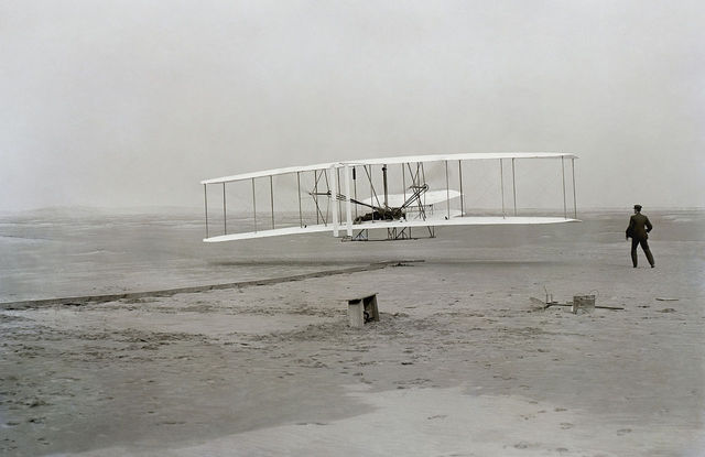 Orville and Wilbur Wright Fly the First Motorized Airplane