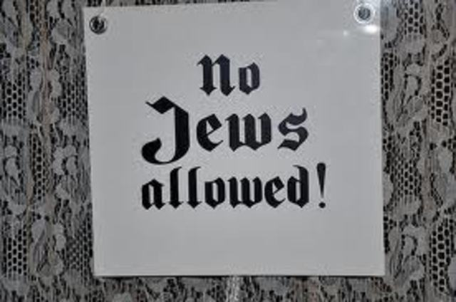 """No Jews"" signs and notices are posted outside German towns and villages, and outside shops and restaurants."