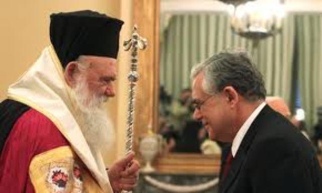 Papademos sworn-in (Reuters)