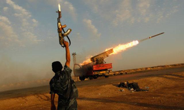 Libyan families flee Gaddafi forces in Ajdabiya as civilian death toll rises