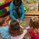 Teacher w 5 kids playing