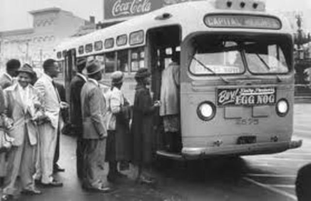 Montgomery bus system desegregates.
