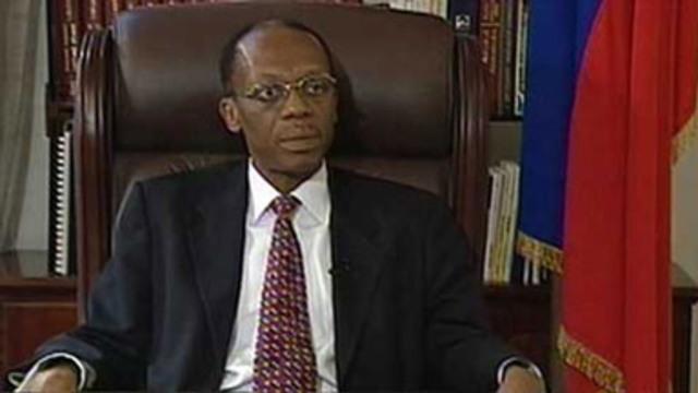 Aristide goes into exile again