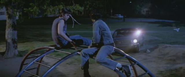 who do ponyboy and johnny meet at the fountain in park