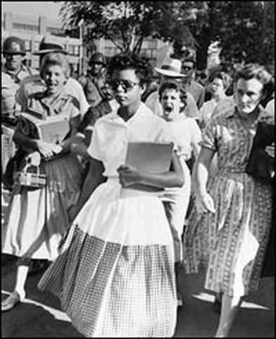 African American students attend a non segregated school for the first time
