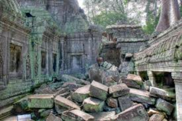 Khmers abandon Angkor,jungle grows around and over Angkor and location forgotten