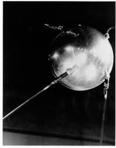 The first orbiting object was launched into space (Sputnik I)