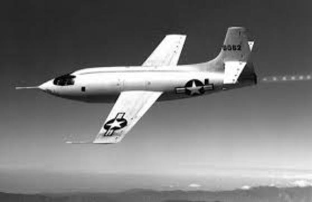"""U.S. Air Force pilot Captain Charles """"Chuck"""" Yeager becomes the fastest man alive when he pilots the Bell X-1 faster than sound for the first time on October 14 over the town of Victorville, California."""