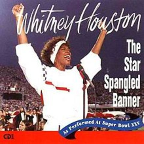 "Whitney sings ""The Star Spangled Banner"" on Tampa Field.  The recording is released as a charitable album with proceeds supporting armed forces."