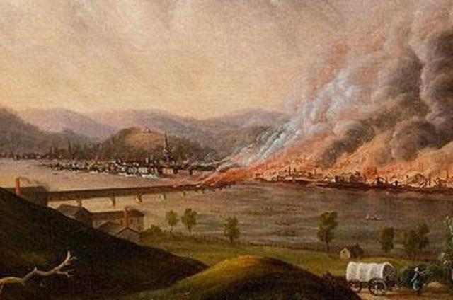 A fire ravages the city