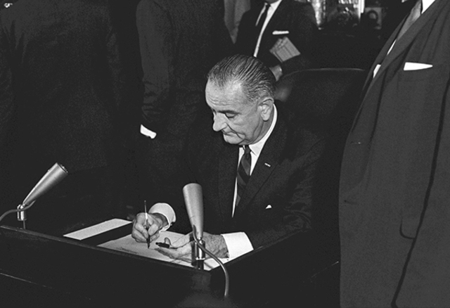 President Johnson signs Voting Rights Act of 1965 into law