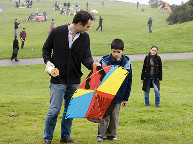Sohrab is taught how to fly a kite.