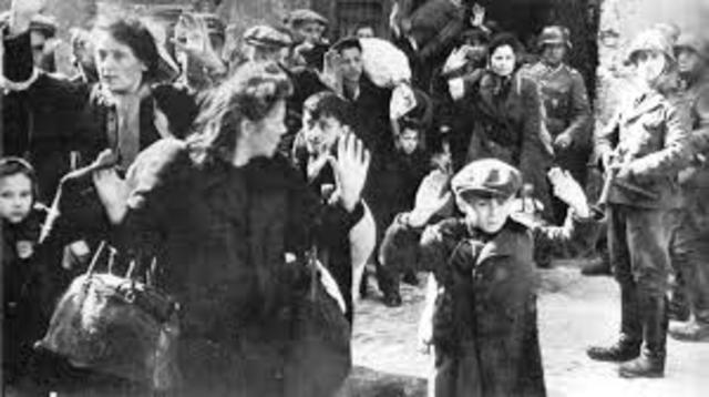 Einsatzgruppen shoot 10,000 Jews from the Riga ghetto in the Rumbula Forest.