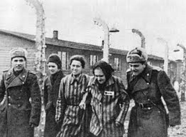 Soviet troops liberate the Auschwitz camp complex.